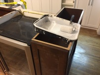 If we don't have countertops, then why not? Multi-functional island.